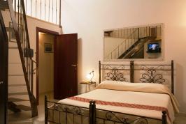 Mooie slaapkamer B&B Carlo Felice.
